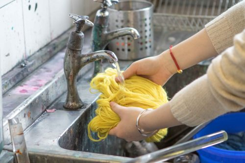 Rinsing the dyed wool.